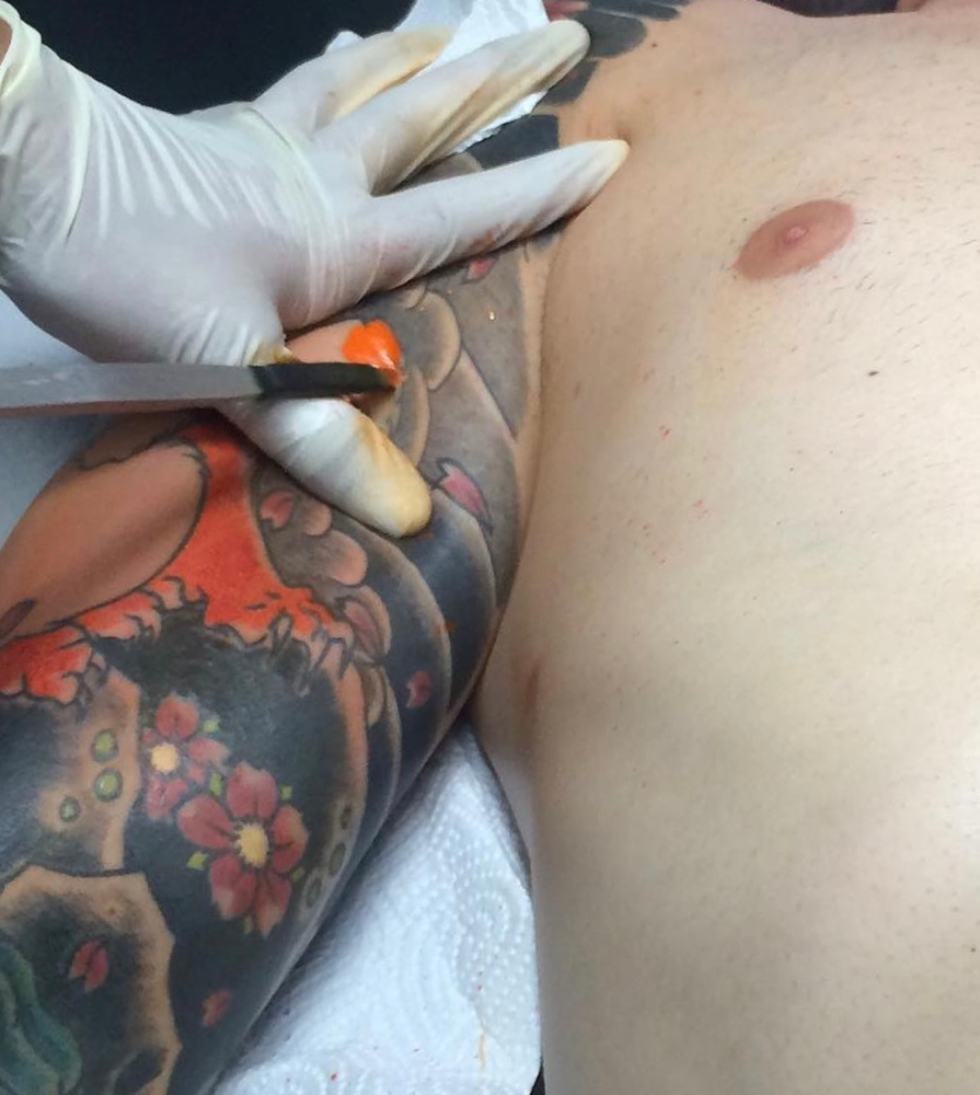 hand poking a traditional japanese tattoo